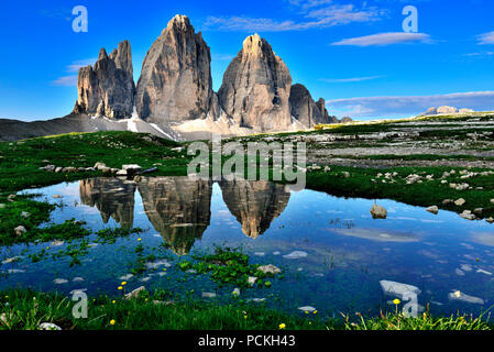 North walls of the Three Peaks of Lavaredo are reflected in the water, Sexten Dolomites, Hochpustertal valley, South Tyrol - Stock Photo