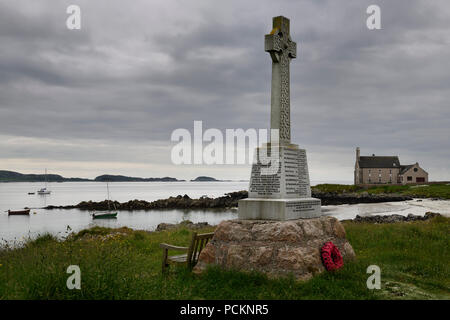 Marble Celtic cross war memorial on Martyr's Bay Sound of Iona South of Baile Mor village on Isle of Iona Inner Hebrides Scotland UK - Stock Photo