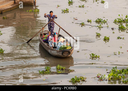 Soc Trang, Vietnam - April 5, 2018: Buying and selling agricultural products on Mekong River. Boat women sell fruit, flowers, agricultural products on - Stock Photo
