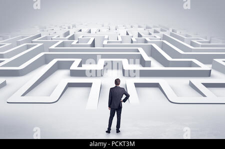 Businessman getting ready to enter a 3D flat labyrinth concept  - Stock Photo