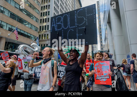 New York, United States. 02nd Aug, 2018. Patricia Okoumou, Statue of Liberty climber - Members of the activist group Rise and Resist organized a protest at Wall Street in the financial district on August 2, 2018 as part of the four days of protests targeting local politicians and business profiting from ICE. On their last day of actions, activists called out on big banks and businesses profiting from ICE, demanding that Wells Fargo, Bank of America, and JPMorgan Chase stop extending credit to The GEO Group and CoreCivic. Credit: PACIFIC PRESS/Alamy Live News - Stock Photo