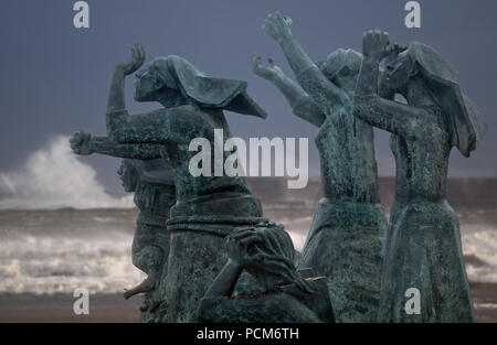 Matosinhos, Portugal - August 1, 2015: Sculptural ensemble by Jose Joao Brito, located in Matosinhos beach near the port of Leixoes, inspired by a pai - Stock Photo