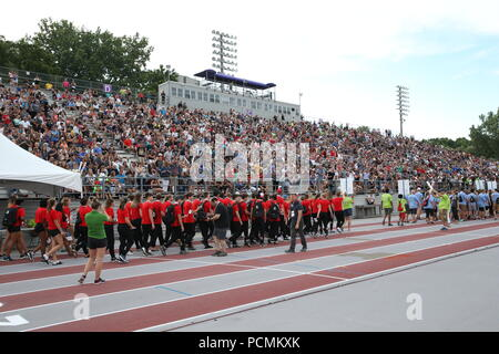 London, Ontario, Canada. Aug 2nd 2018, 3500 athletes from all over Ontario gathered at TD Waterhouse Stadium for the 2018 Ontario summer games opening ceremonies. The athletes entered the stadium in a parade watch musical performances by Courage My Love and Scott Helman, Others in attendance Brad Biederman, Sariyah Hines, Sylvia Jones, Harold Usher, Bill Merrylees, Carson Lumley, Damian Warner and 2018 Gold medalist Alex Kopacz who lit the new 2018 Ontario summer games torch. 2018 Athletes enter TD Waterhouse Stadium. Luke Durda/Alamy Live news - Stock Photo