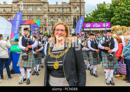 Glasgow, UK. 3rd August 2018. The Lord Provost of Glasgow, EVA BOLANDER, took the lead in parading the National Youth Pipe Band and Friends into George Square, Glasgow as part of the Glasgow Festival 2018, the European Games celebrations and as an introduction to Piping Live which starts on 13 August in the city. The Lord provost also took time to meet some of the pipers and have an informal chat with them. Credit: Findlay/Alamy Live News - Stock Photo