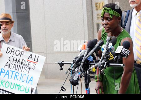New York, NY USA. O3 Aug, 2018. Therese Patricia Okoumou, 44, the woman who was arrested on 4th. July, 2018, after  after she climbed onto the base of the Statue of Liberty to protest the Trump administration's immigration policies, after she made a procedural court appearance in New York City on 3 Aug, 2018. The 'Rise and Resist' activist was  ordered to reappear in court on 1st. October, 2018. © 2018 G. Ronald Lopez/DigiPixsAgain.us/Alamy Live News - Stock Photo