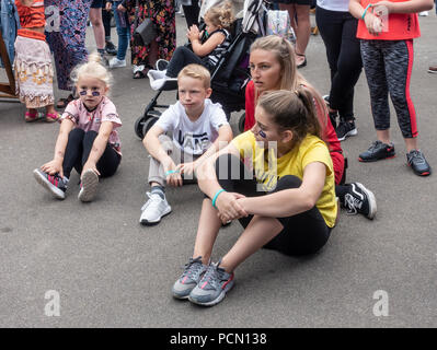 George Square; Glasgow; Scotland. 03rd August 2018. People out and about in George Square in the centre of Glasgow relaxing and enjoying Festival 2018. Two young girls are wearing European Championships stickers on their cheeks. The festival is running in parallel with the European Championships; Glasgow 2018. George Square is a free venue with several live and virtual attractions daily. Credit: Elizabeth Leyden/Alamy Live News - Stock Photo