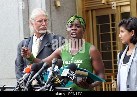 New York City, New York, USA. 3rd Aug, 2018. THERESE PATRICIA OKOUMOU, 44 (C), the woman who was arrested on July 4, 2018, after she climbed onto the base of the Statue of Liberty to protest the Trump administrations immigration policies, is flaked by her legal team outside the U.S. Federal Court House in Lower Manhattan after she made a procedural court appearance. The 'Rise and Resist' activist was ordered to reappear in court October 1, 2018. Credit: G. Ronald Lopez/ZUMA Wire/Alamy Live News - Stock Photo