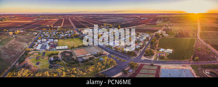 Aerial panorama of Monash - small town in South Australia and farmlands at sunset - Stock Photo