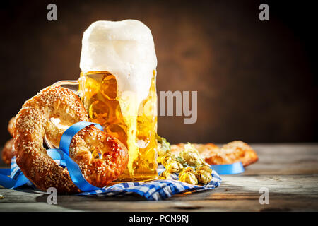 Beer mugs and pretzels on a wooden table. Oktoberfest. Beer festival. - Stock Photo
