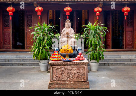 Avalokitesvara shrine in the One Pillar Pagoda Complex, Hanoi, Vietnam - Stock Photo