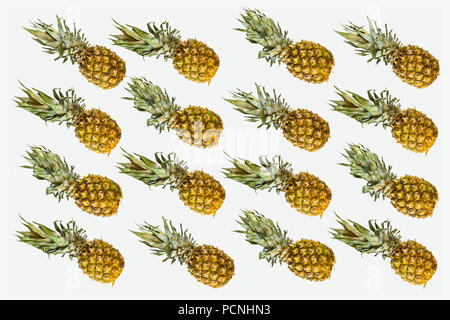 Isolated pineapples pattern on white background. Summer concept of fresh ripe whole pineapples shot from above - Stock Photo