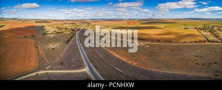 Wide aerial panorama of vast plains of agricultural land in South Australia on bright sunny day - Stock Photo