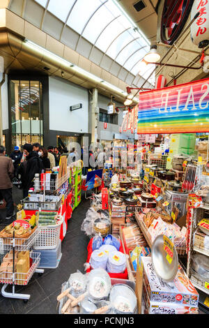 Kuromon Ichiba, food market in Osaka. Corner stall part of shop selling household and kitchen goods. Large display of goods with aisle through. - Stock Photo