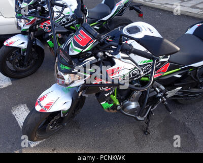Two motorbikes lined up ready for pupils to learn to ride and pass their motorcycle drivers license test. The handle bars have steal crash safety bars - Stock Photo