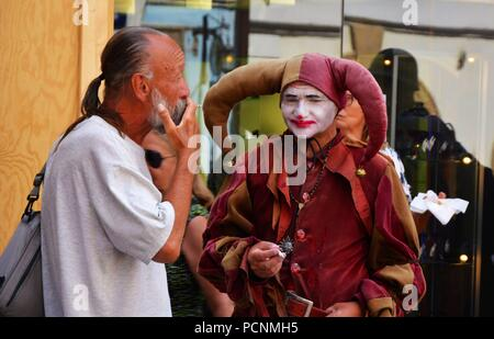 The jester in Prague street - Stock Photo