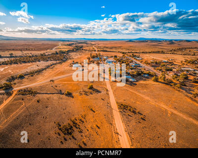 Aerial view of a small town in vast plains of South Australian outback - Stock Photo