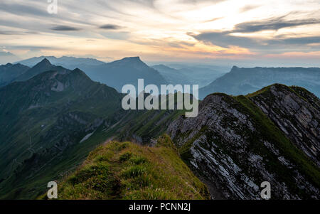 panoramic mountain view from the peak of the brienzer rothorn in the swiss alps - Stock Photo