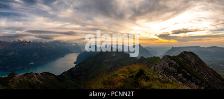 panorama view from the top of a mountain to lake during sunset, brienzer rothorn switzerland alps - Stock Photo