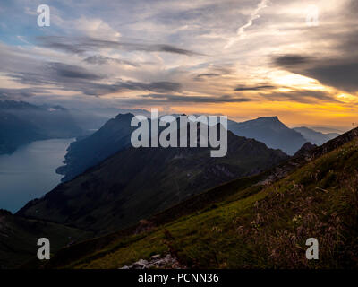 panoramic mountain view from the peak of the brienzer rothorn in the swiss alps dramatic sunset - Stock Photo