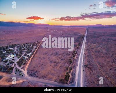 Vast plains of barren land of South Australia at sunset - Stock Photo