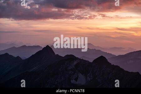 dramatic sunset over mountain range in the swiss alps brienzer rothorn switzerland - Stock Photo