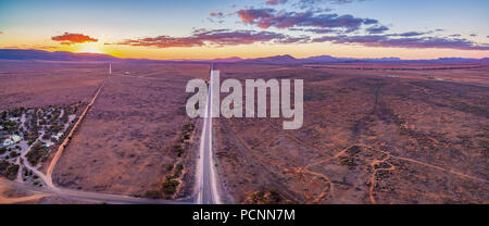 Vast plains of barren land in South Australia at sunset - aerial panorama - Stock Photo