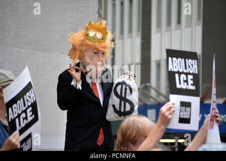 Man dressed as Donald Trump at protest against ICE on Wall Street in Lower Manhattan. - Stock Photo