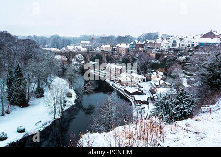 A winter landscape with viaduct in Knaresborough in North Yorkshire during snowy day in England. Winter photo in cool colors.  River Nidd - Stock Photo