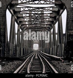 Old 'Long Bien#- railway bridge over the Red River in Hanoi, Vietnam - Stock Photo