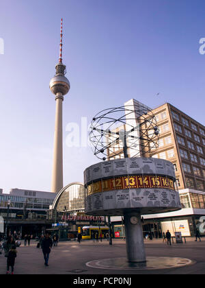 Berlin Alexanderplatz with world time clock, TV tower and train station - Stock Photo