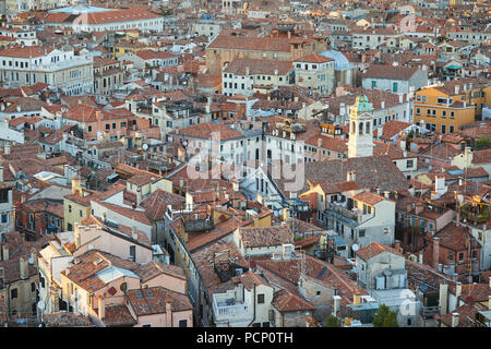 Elevated view of Venice roofs before sunset in summer, Italy - Stock Photo
