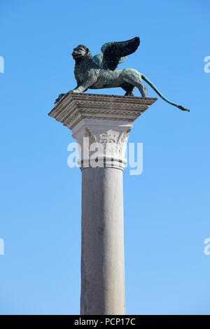 San Marco winged Lion statue on column, symbol of Venice in a sunny day, blue sky in Italy - Stock Photo