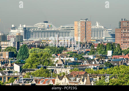 Rotterdam, The Netherlands, August 3, 2018: cruiseship Aida Perla is towering over residential neighbourhoods in the western part of the city - Stock Photo