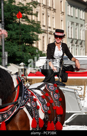 antique horse-drawn carriages around market square old town krakow, lesser poland, poland, europe - Stock Photo