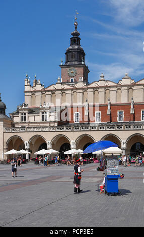people infront of Cloth Hall. old town krakow, lesser poland, poland, europe - Stock Photo