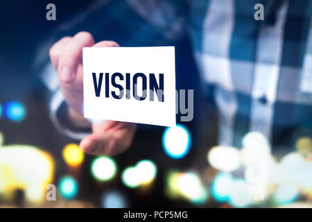 Vision, future ideas, forethought and development concept. Business man, marketing and branding professional or consultant holding card. - Stock Photo