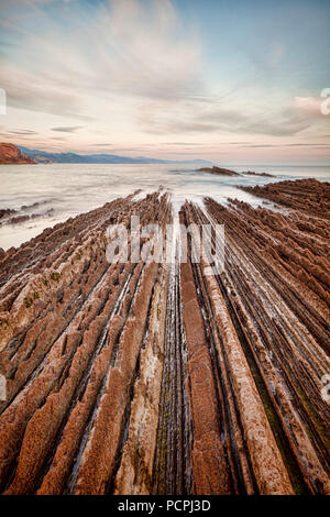 Flysch formations in the geological park at Itzurun Beach, Zumaia, Basque Country, Spain. - Stock Photo