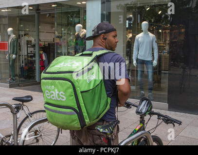 Uber Eats, an American online food ordering and delivery; cyclist in Fishergate, Preston, Lancashie, UK - Stock Photo