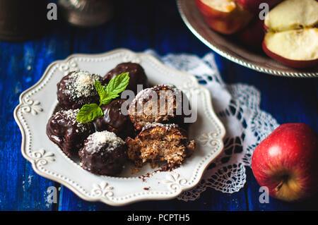 Chocolate truffles with apple and cinnamon. Sweet homemade dessert handmade. - Stock Photo