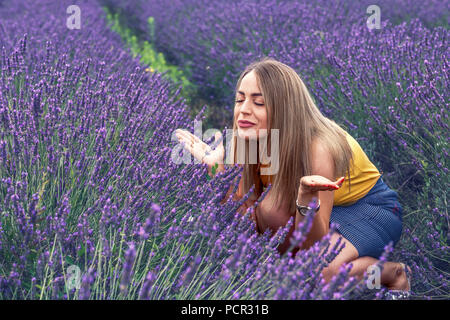 Young woman in lavender field on beautiful summer day - Stock Photo
