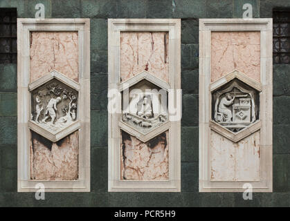 Hexagonal relieves by Italian Renaissance sculptor Andrea Pisano (1334-1343) on the Giotto's Campanile (Campanile di Giotto) in Florence, Tuscany, Italy. The work of Adam and Eve, Jabal as personification of the beginning of sheepherding and Jubal as personification of the beginning of the art of music are depicted from left to right. - Stock Photo