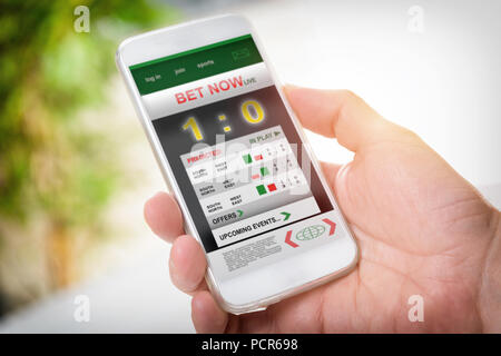 male hand with sport application on smartphone Stock Photo