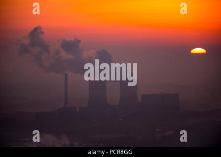 RWE Power coal power plant in sunrise with cloud of smoke, cooling towers, former high-temperature reactor, former nuclear power plant, Hamm, Ruhr area, North Rhine-Westphalia, Germany - Stock Photo