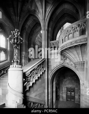 John Rylands Library, Deansgate, Manchester, 1900. Interior view, showing a staircase and architectural details as seen from a half-landing. The library was completed in 1899 to the designs of architect Basil Champneys, and was commissioned by Enriqueta Augustina Rylands in memory of her late husband, a Manchester textile manufacturer and philanthropist. The library is a fine example of Victorian Gothic Revival architecture. It later became part of the University of Manchester. - Stock Photo