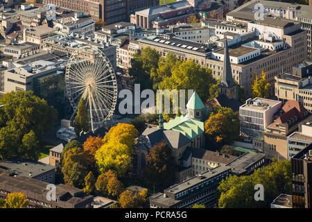 Ferris wheel at Essen Cathedral, Essen, Ruhr area, North Rhine-Westphalia, Germany - Stock Photo