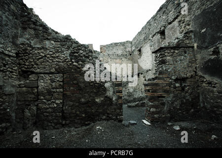 Ruins of a residential building at the ancient city of Pompeii, near Naples, Italy - Stock Photo