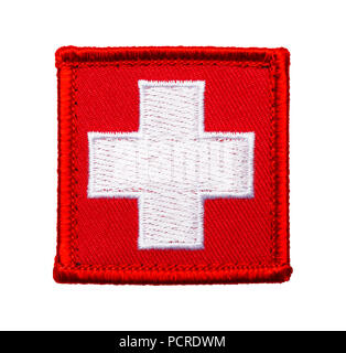 Red Medical Cross Patch Isolated on a White Background. - Stock Photo