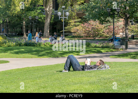 ANN ARBOR, MI/USA - OCTOBER 20, 2017: Unidentified individuals on the campus of the University of Michigan. - Stock Photo