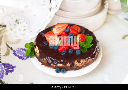 Cake with fresh berries and cream on old wooden background. Selective focus - Stock Photo