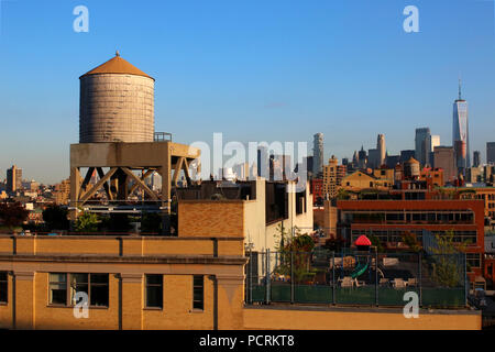 Rooftop view of a watertank and Lower Manhattan skyline, Meatpacking District, Manhattan on JULY 7th, 2017 in New York, USA. (Photo by Wojciech Migda) - Stock Photo